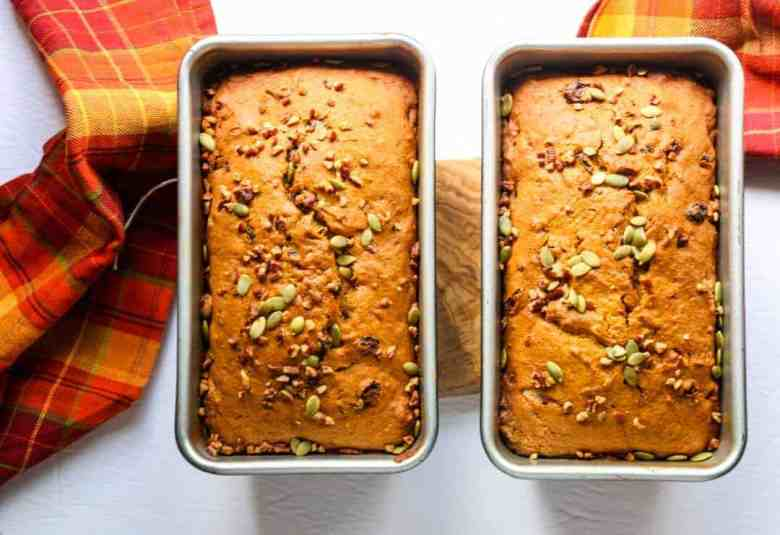 Two baked pumpkin spice loaves in breadpans