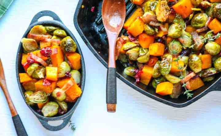 A dish is filled with food, with Brussels sprouts and Butternut squash