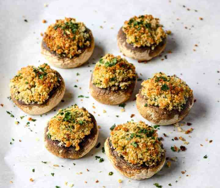 A plate of food, with Stuffed mushrooms