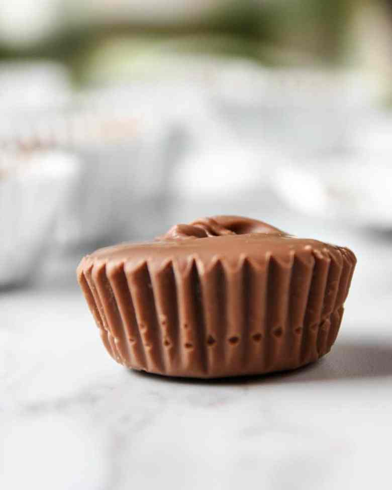 A close up of a peanut butter cup sitting on top of a table