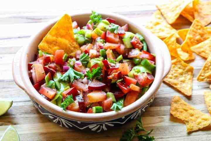 A bowl of salsa, with Tortilla chip