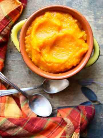 A serving dish of roasted garlic butternut squash puree