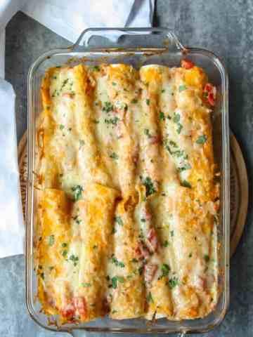 Baking dish of seafood enchiladas