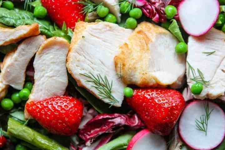 salad with chicken, strawberries, asparagus, peas an radish