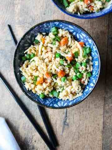 A bowl of food with rice and broccoli