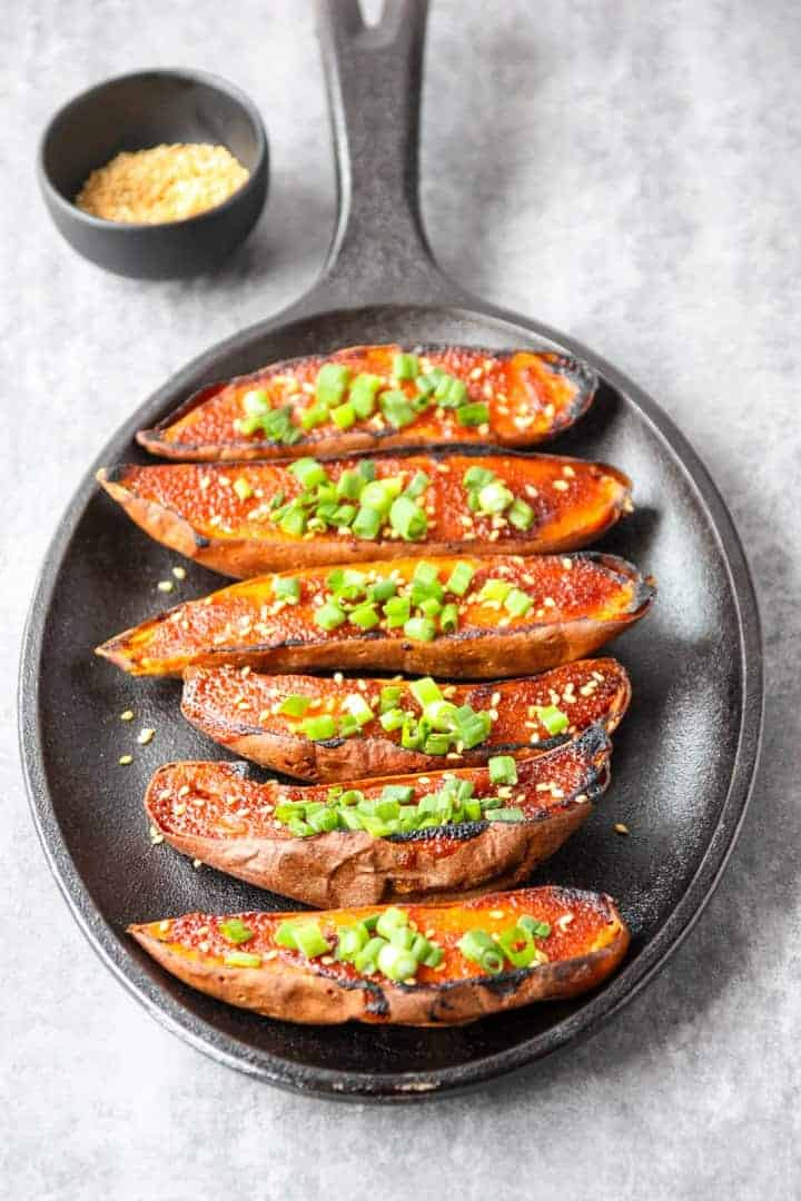 A pan of roasted sweet potatoes on a table