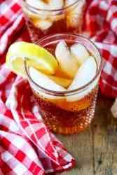 A glass on a table, with Iced tea