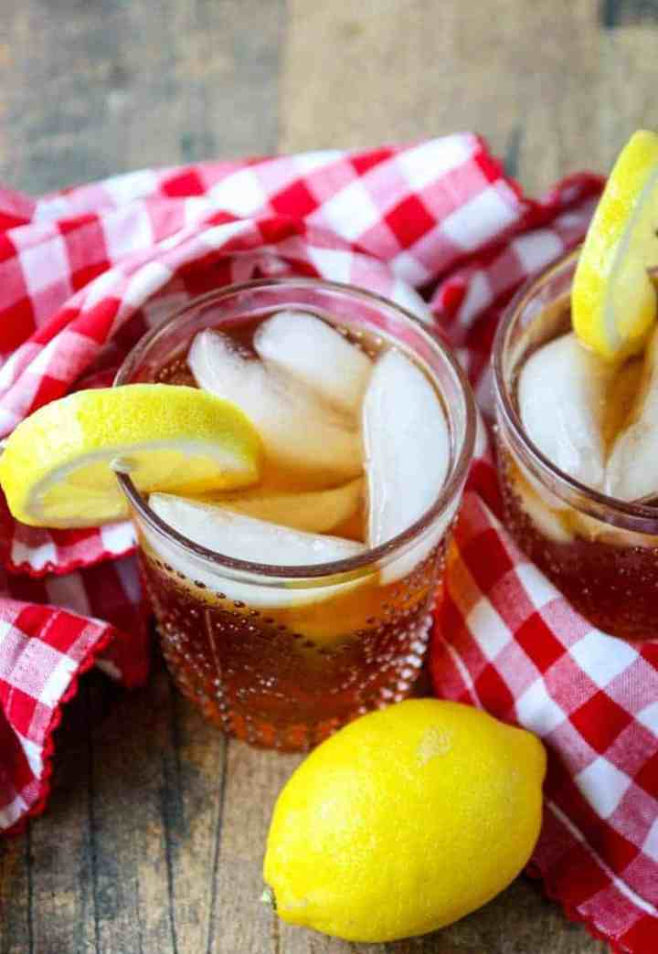 2 glasses of spiked iced tea with lemon slices