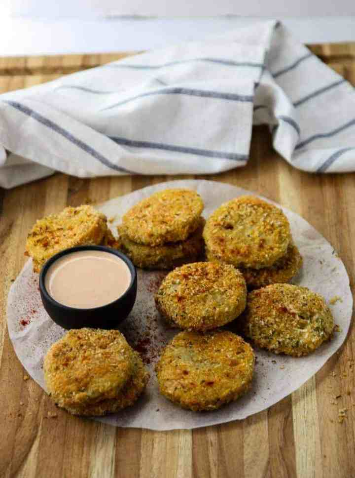 Oven Fried Green Tomatoes on parchment on a wooden table