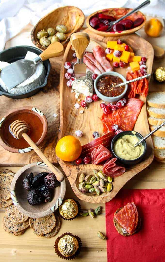 A half empty meat and cheese board