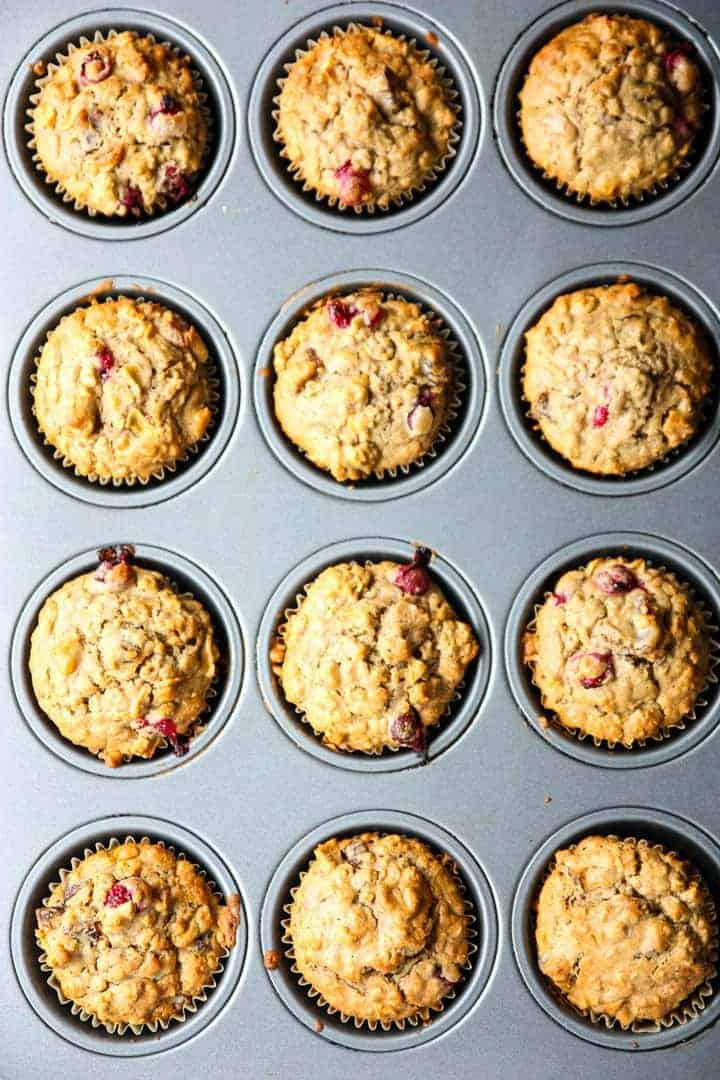 A muffin tin full of cranberry apple oatmeal muffins