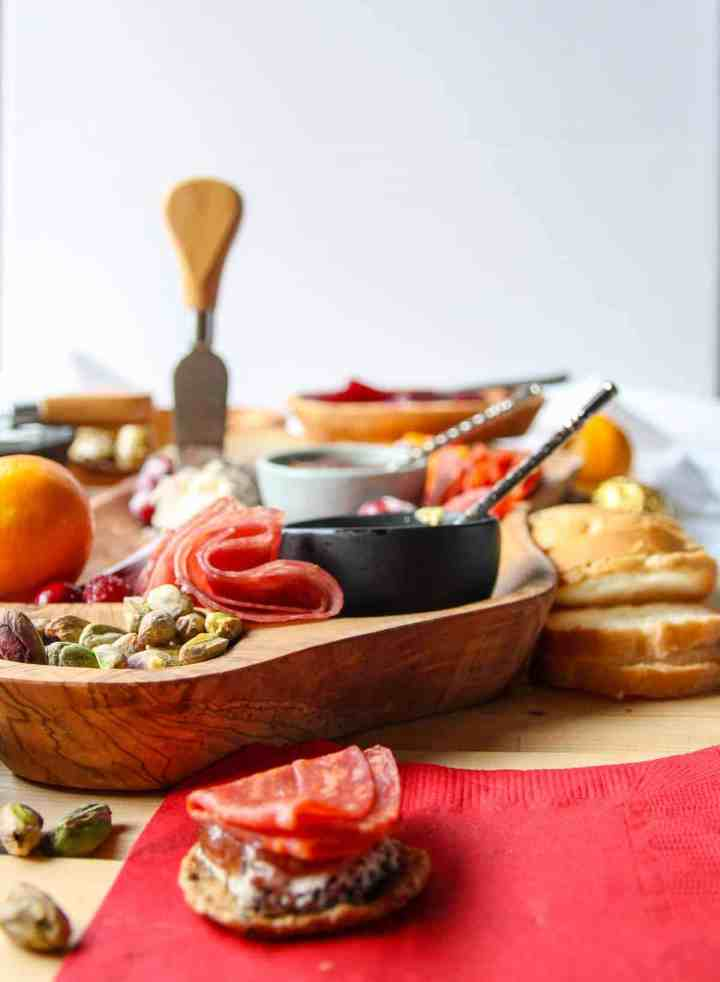 A holiday charcuterie board with meat, cheese, and fruit