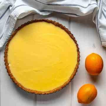 A Meyer Lemon Curd Tart on a table.