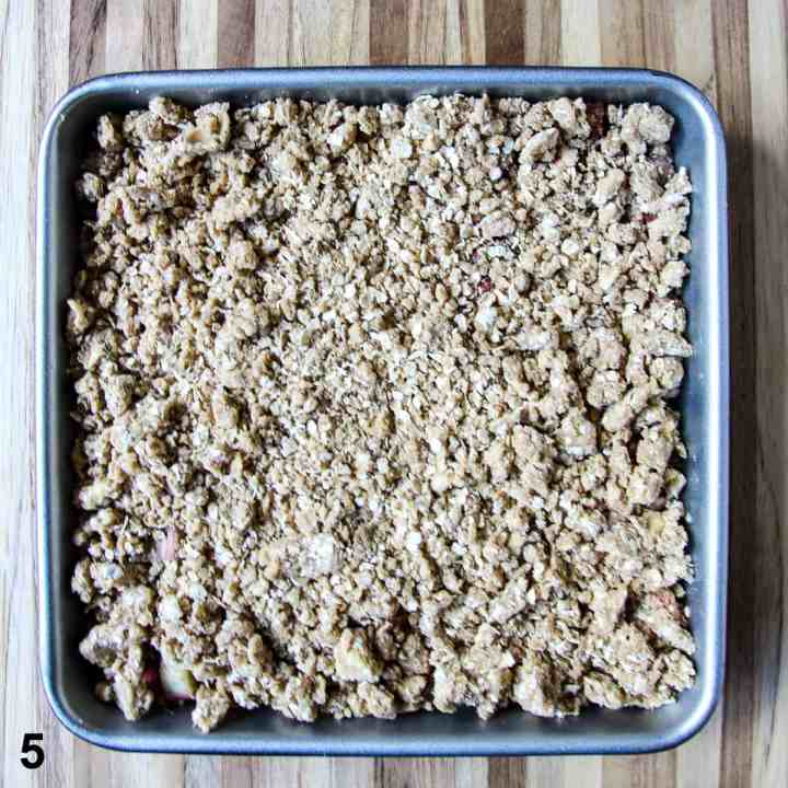 The topping is spread over the filling in the baking pan.
