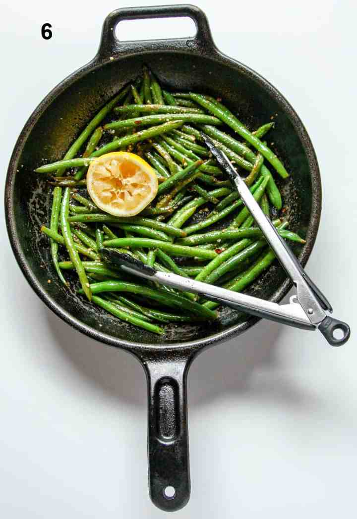 A pan of green beans with a lemon.