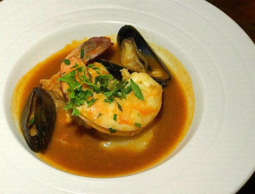 Ponsatys french dinner series poached seafood saffron broth