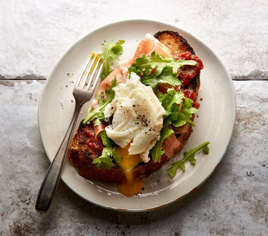 commercial food, food photography, advertising, restaurant, editorial, cookbooks, cook books, table top, dining, drinks, beverage, food styling, prop styling, poached eggs, toast, brunch, prosciutto, tomato jam, arugula, Ralph Smith Food Beverage Photography
