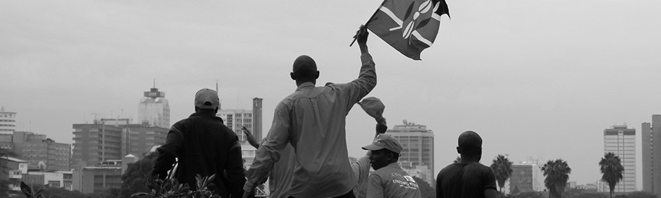 A supporter waves a Kenyan flag at the rally.