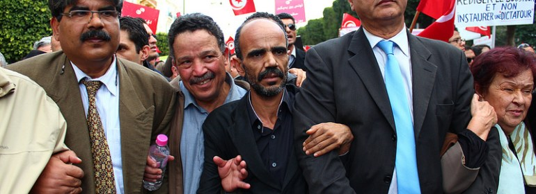 Brahmi at a protest, on the far left
