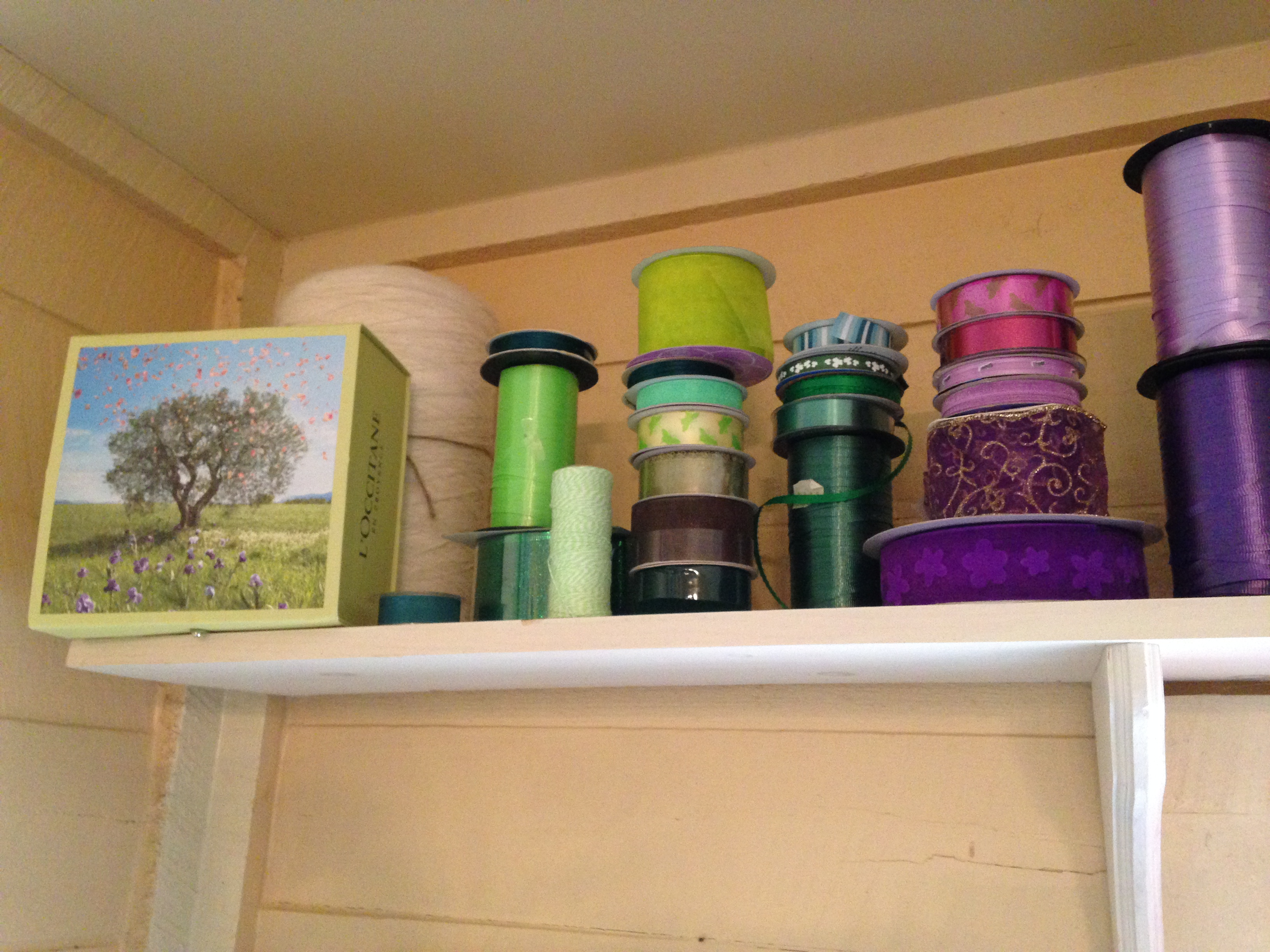 I store my ribbons spools on a shelf that my mom and dad made for me, above the window area.