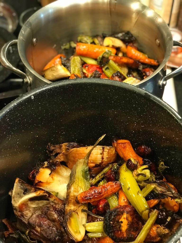 roasted beef bones and veggies in stock pots | www.thefreshcooky.com