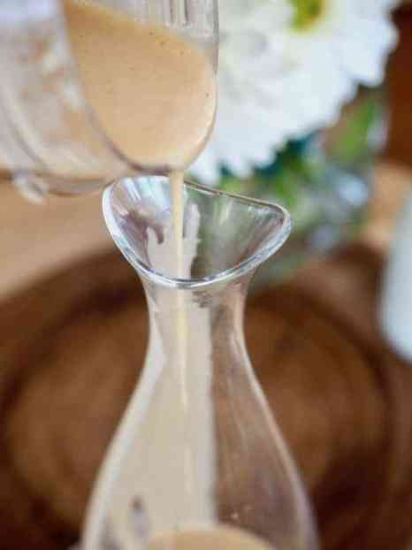 pouring vinaigrette into jar | www.thefreshcooky.com