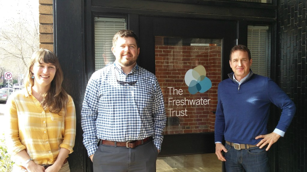 Kate Anderson, Freshwater Solutions program associate, Alex Johnson, Senior Freshwater Solutions director, and David Primozich, senior director of Ecosystem Services, in front of the new Sacramento office