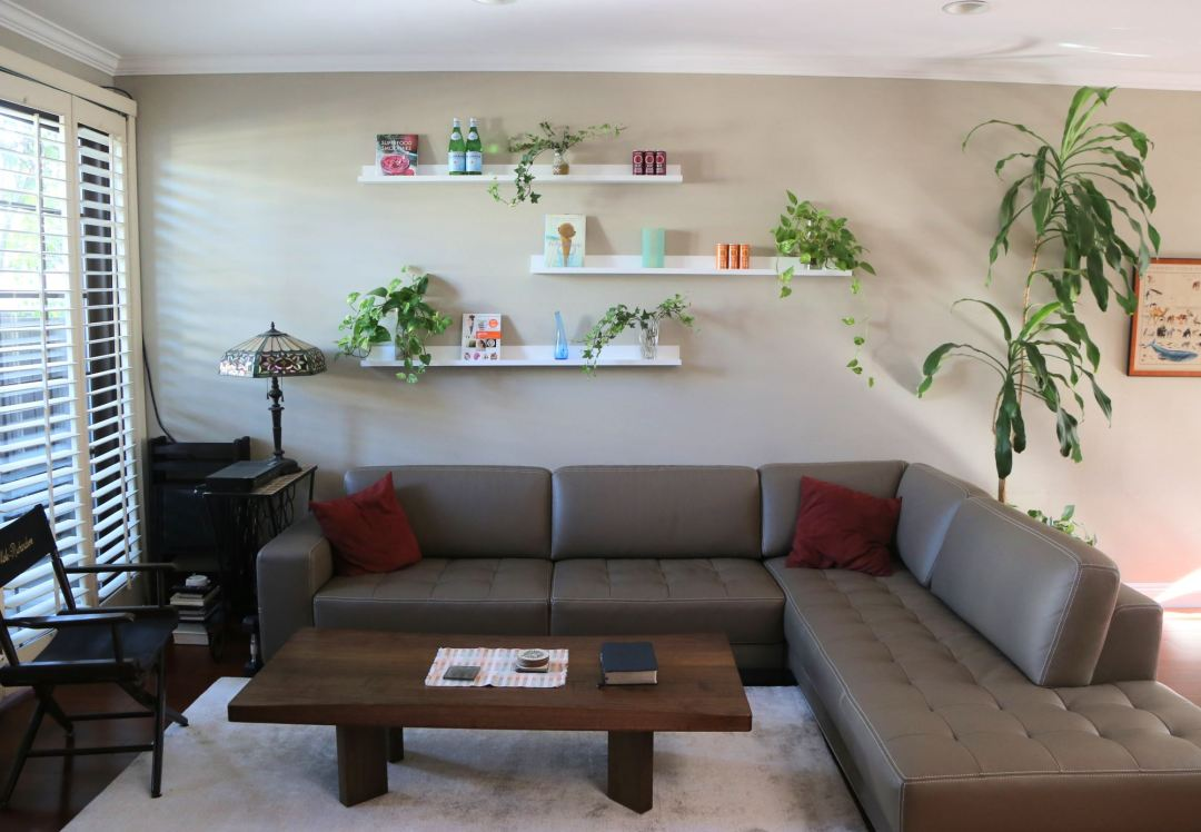 Floating living room shelves create a living wall