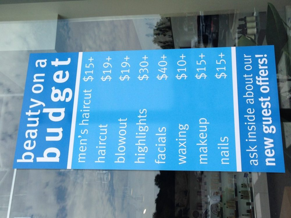 sign showing services with pricing