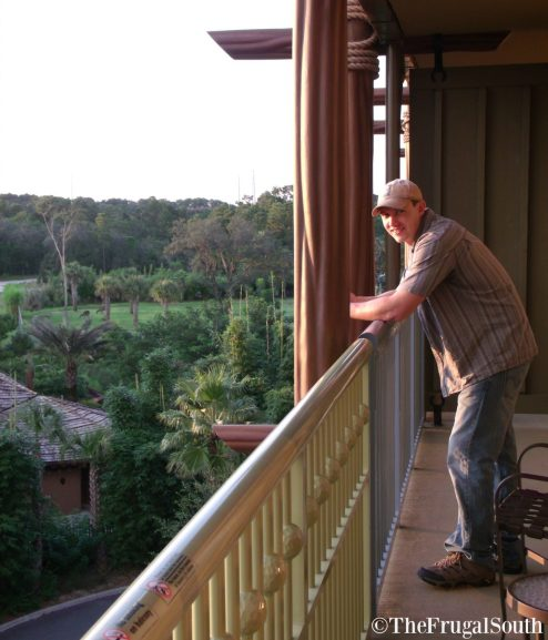 man on room balcony at Animal Kingdom Lodge Resort