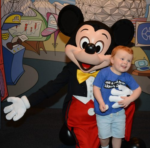 little boy meeting mickey mouse
