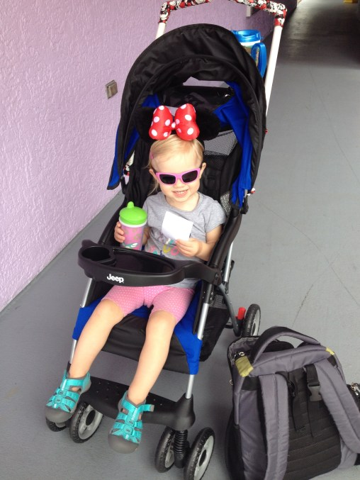 little girl in a stroller