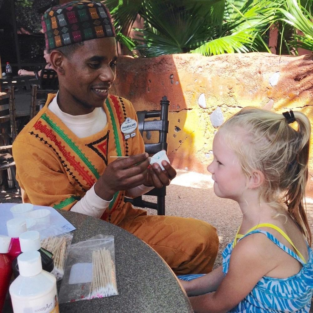 little girl having her face painted