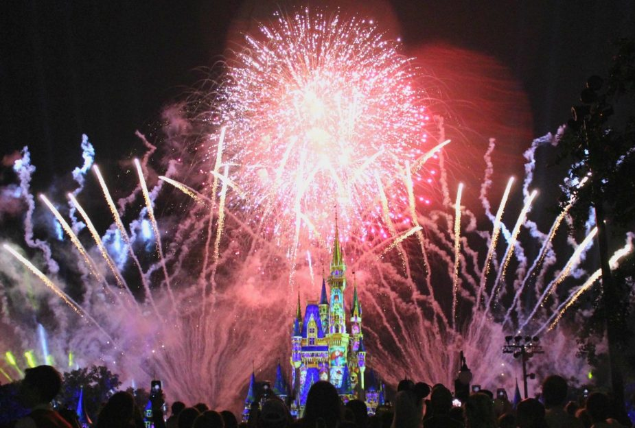 fireworks at night over cinderella's castle