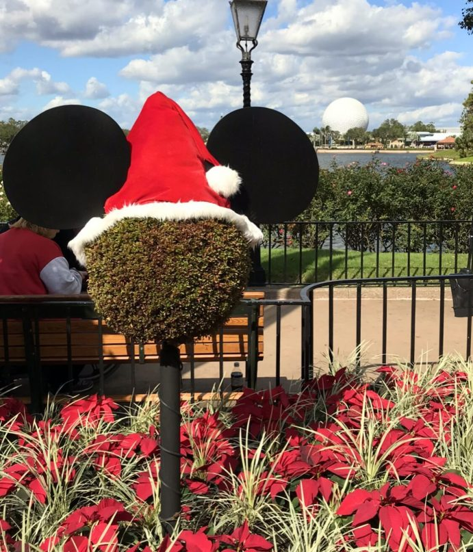 How to take a Disney World Christmas trip on a budget! The ultimate guide to a cheap trip to Walt Disney World during the holidays. #disneyworld #familytravel #budgettravel