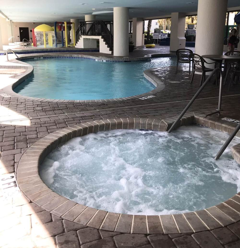 covered pool and hot tub area