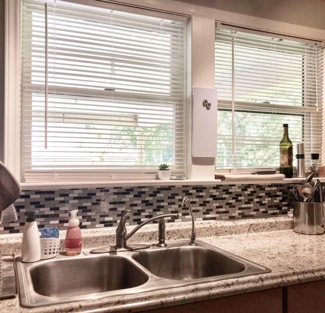 kitchen sink area with new back splash - peel and stick backsplash review