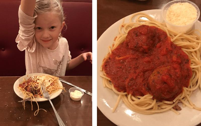 girl eating spaghetti and meatballs