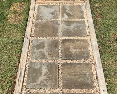 walkway made from concrete stepping stones and gravel