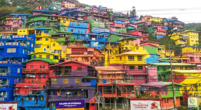 "Known as the ""Valley of Colors"", Stobosa Hillside Homes is a community of rows after rows of 200 colorful houses at the hillside of La Trinidad, Benguet. It is an artwork village desinged by the Tam-awan Village group as part of Rev-Bloom Urban Redevelopment Tourism campaign in 2016. To get here, go to Magsaysay Street and take a jeepney with TOMAY signboard. Tell the driver to drop you off where there are colorful houses. Fare is P10. Rating: 2/5"