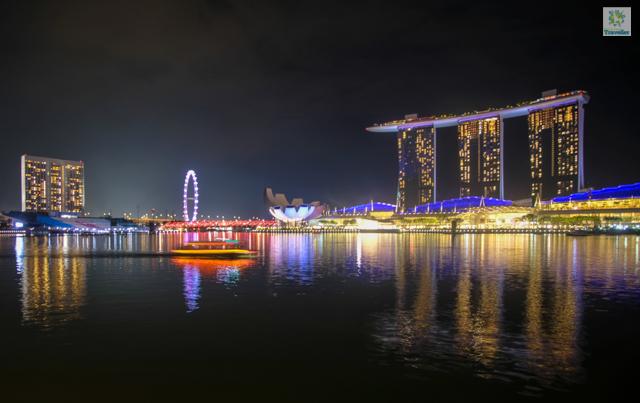 A bumboat cruising towards Marina Bay Sands.