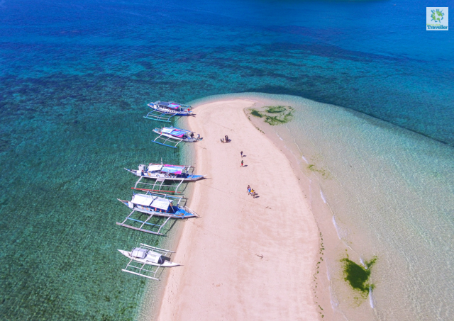 A drone shot of the sandbar in Bantigue Island.