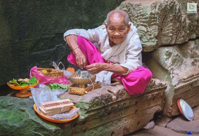 The old woman at Preah Khan temple. She gives blessing to tourists in exchange of a donation.