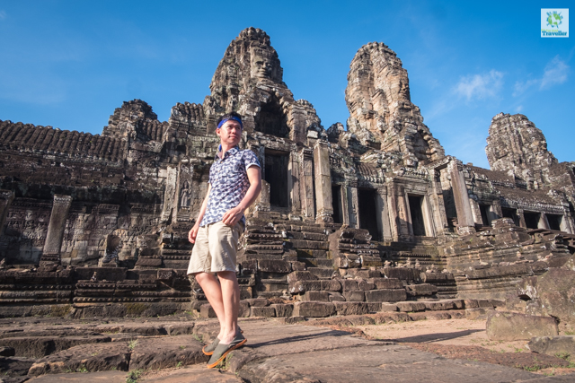 The Fun-sized Traveller at Bayon temple, inside Angkor Thom. Bayon has around 200 faces installed on its temple spires.