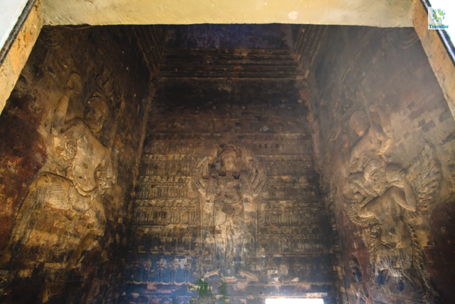The intricate bas-relief of Shiva inside the central tower of Prasat Kravan.