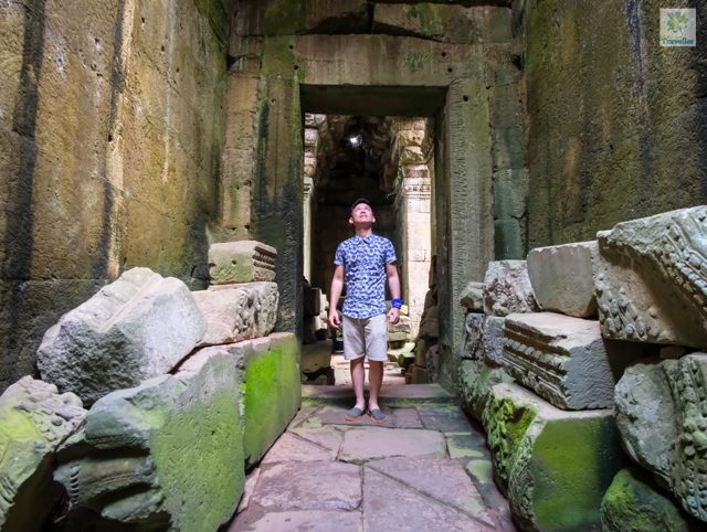 The Fun-sized Traveller looking up the open structure at the central portion of Preah Khan.