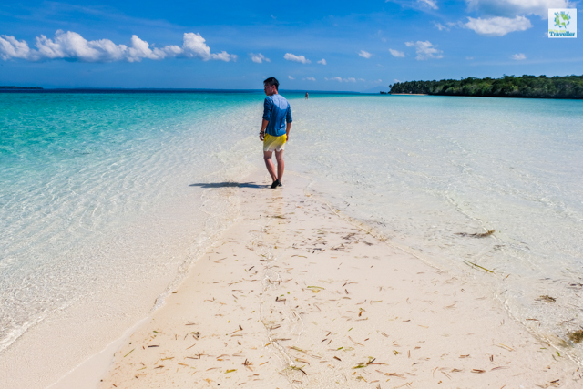 Walking through the sandbar strip of Mansalangan. The tides were starting to rise when we got to the area.