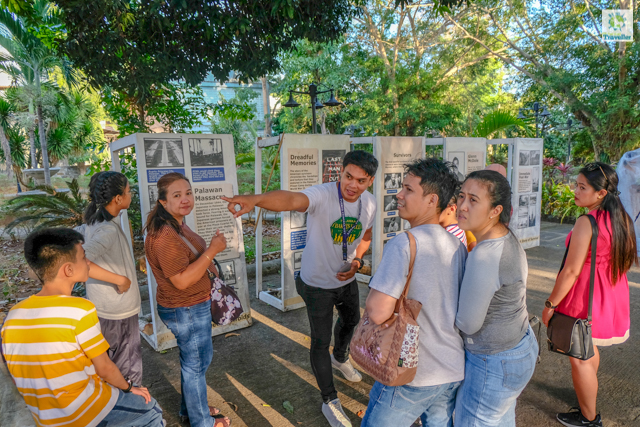 A tour guide sharing stories about Plaza Cuartel.