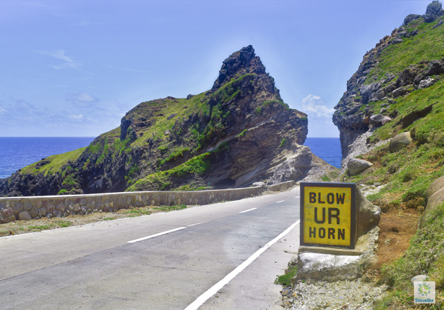 """At the lower right is a clearer view of """"Blow UR Horn"""" sign at Alapad Pass."""