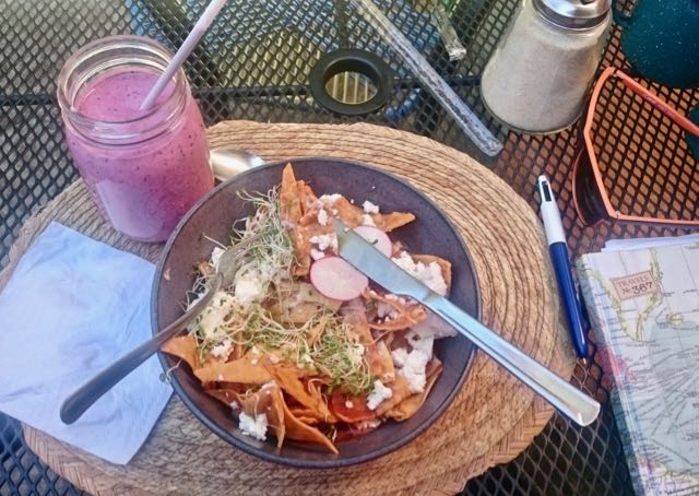 a fresh fruit smoothie and chilaquiles